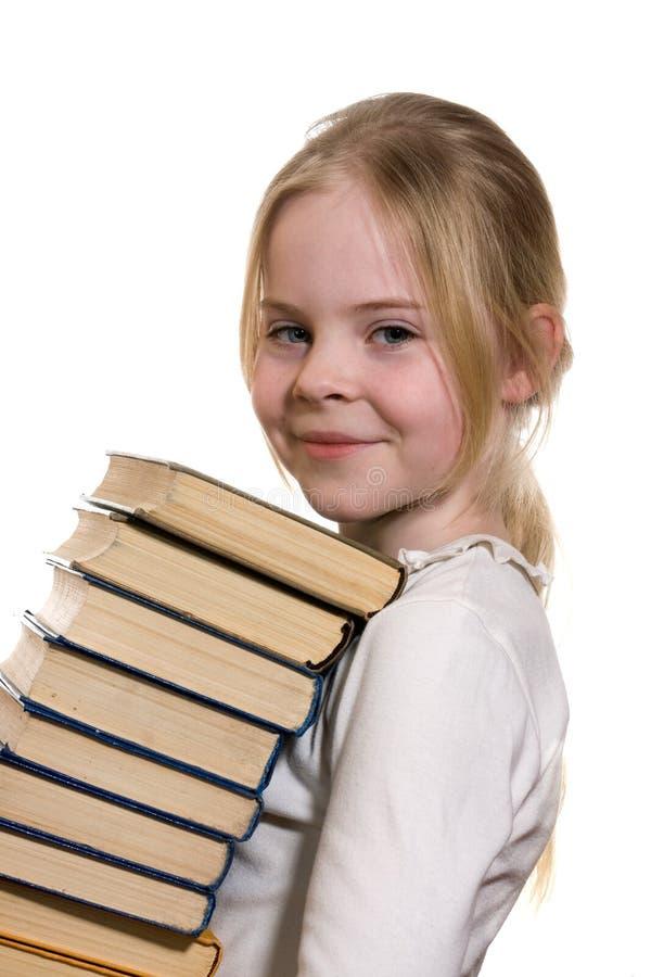 De holdingsstapel van het schoolmeisje van boeken royalty-vrije stock foto's