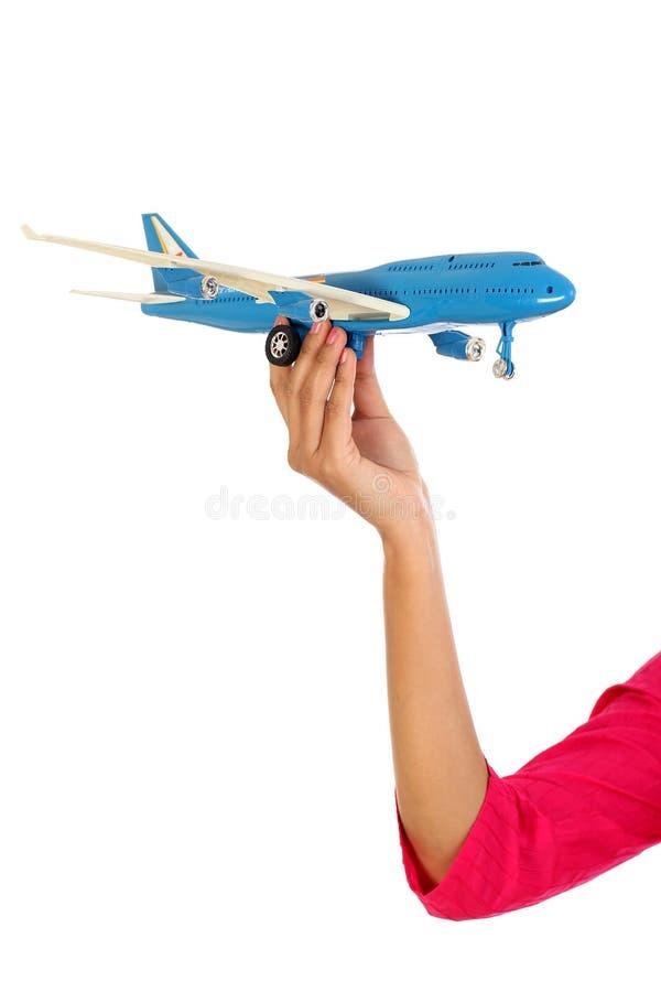 De holdingsstuk speelgoed van de vrouwenhand vliegtuig stock foto's