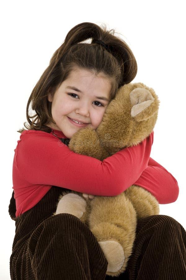 De holdingsteddybeer van het kind stock foto's