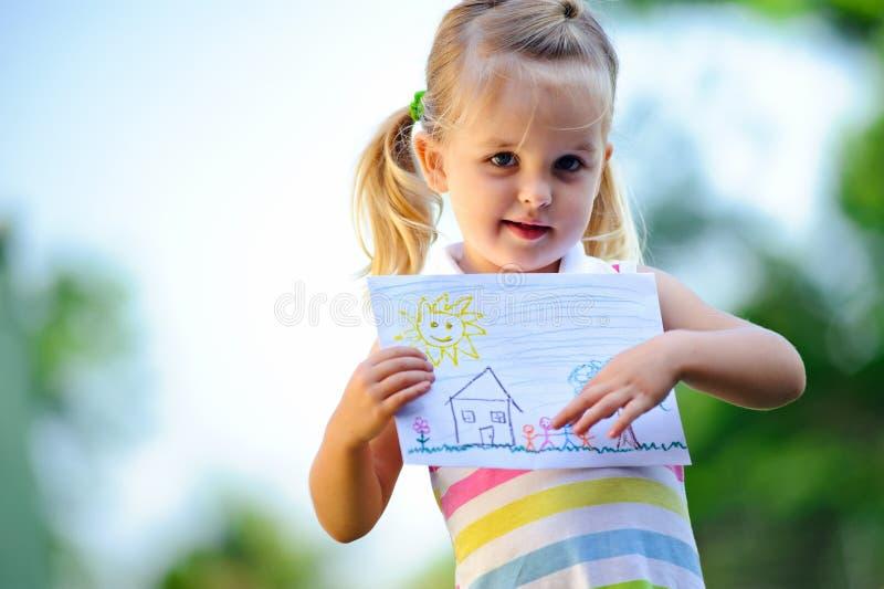 De holdingstekening van het kind stock fotografie