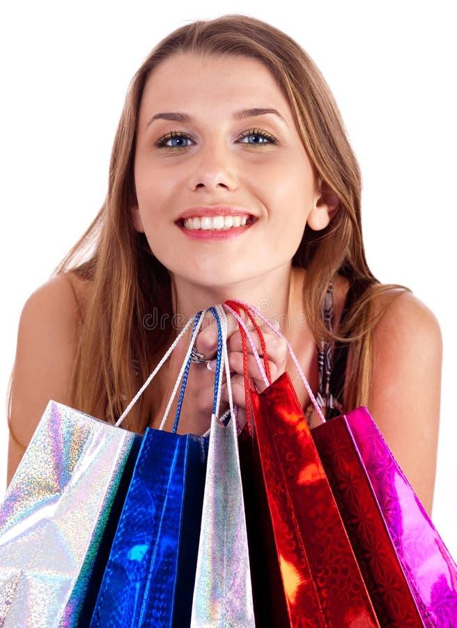 De holdingsveel van de vrouw het winkelen zakken in haar hand royalty-vrije stock afbeeldingen
