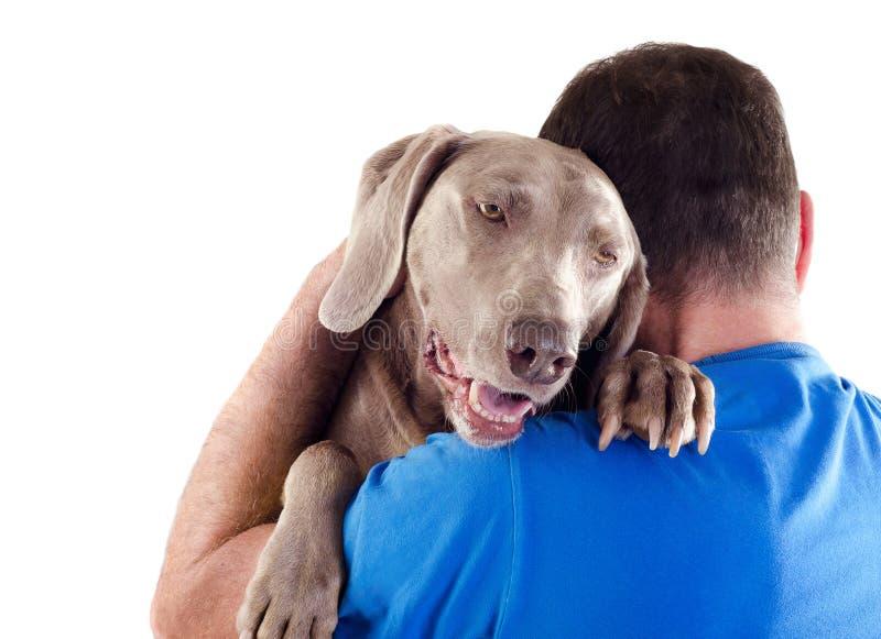 De hond en de mens stock fotografie