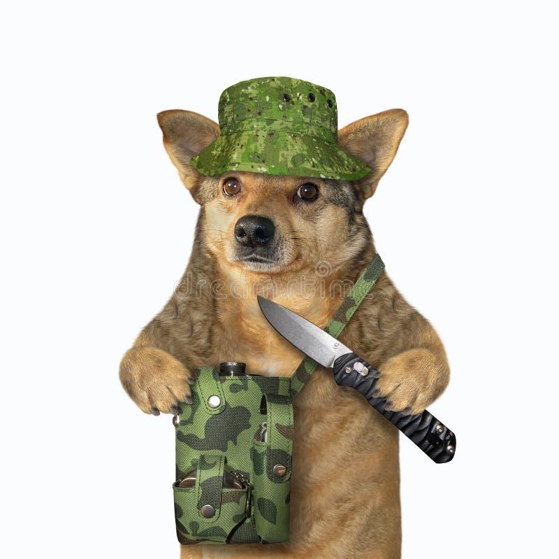 De hondjager houdt een knipmes stock afbeeldingen