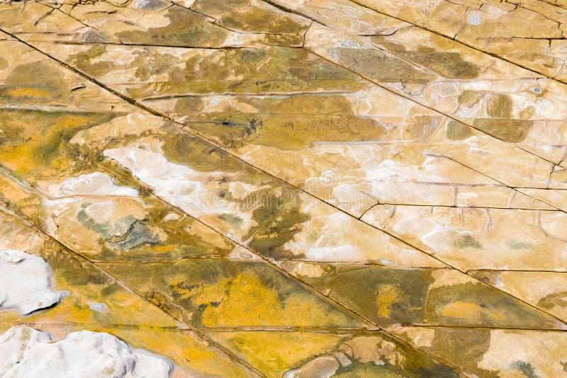 De hoogste luchtmening van zandsteen schommelt patroon op Australische kustlijn stock fotografie