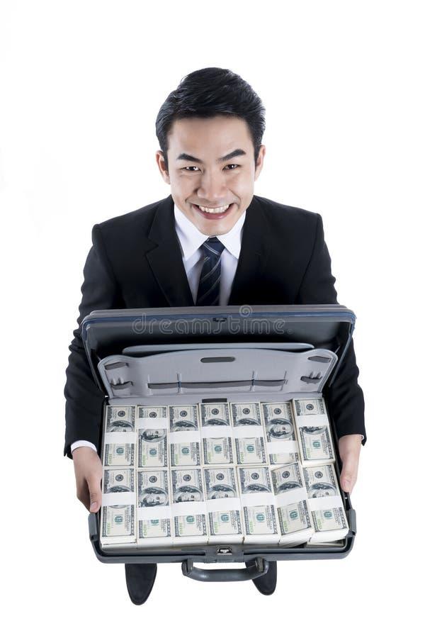 De hoogste mening met de jonge zakenman die en volledig glimlachen houden stock foto's