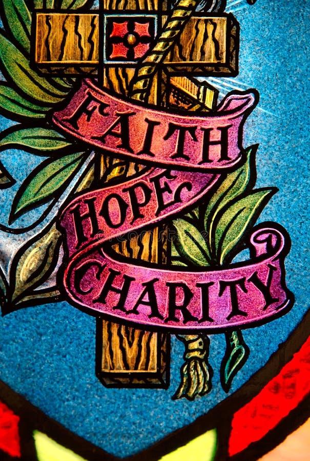 De hoop en de liefdadigheid van het geloof stock afbeelding