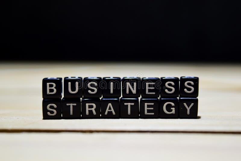 De houten blokken van het bedrijfsstrategieconcept op de lijst royalty-vrije stock afbeelding