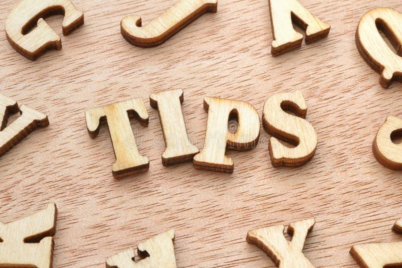 De houten brieven van het uiteindenwoord stock afbeeldingen