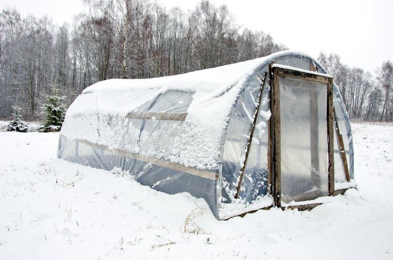 De houten diy eigengemaakte sneeuw van het serrepolytheen royalty-vrije stock fotografie