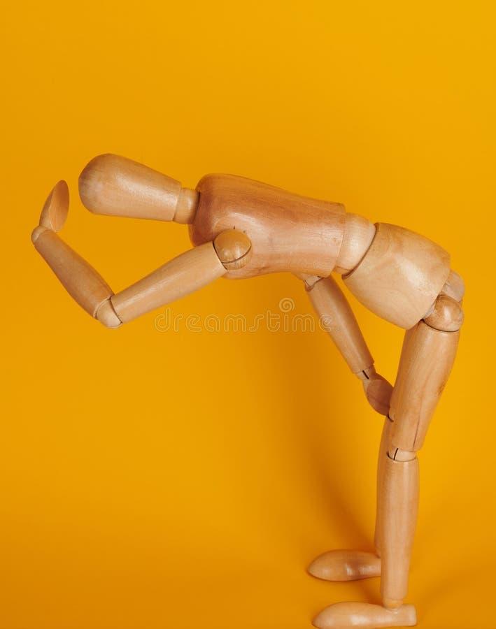 De houten mens in vermoeid stelt stock fotografie