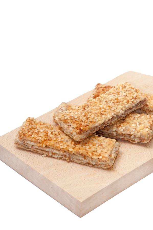 DE HOUTEN RAAD VAN HET GRAANGEWASSENmeatless BROOD SESAM stock afbeelding