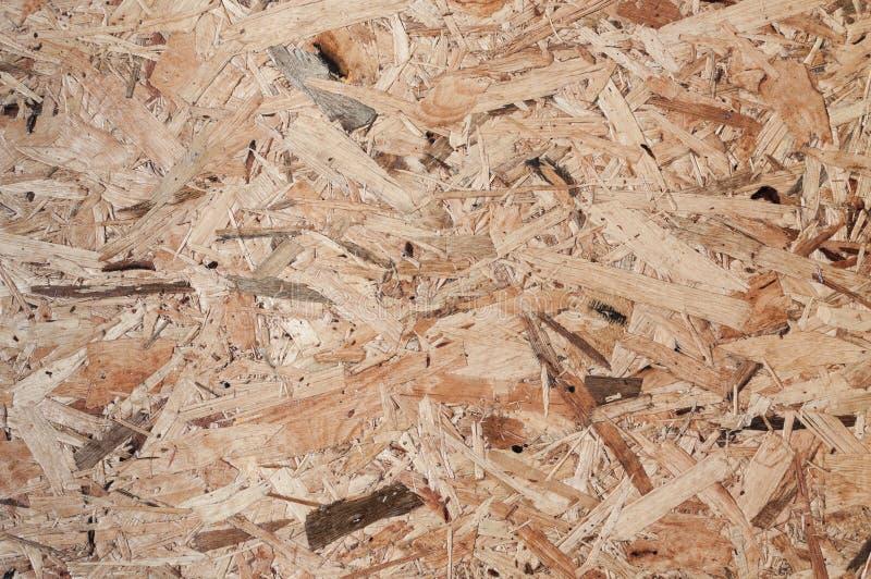 De houten textuurraad maakte van stuk die van houtlapwerk van ruw hout een mooi parket houten patroon vormen royalty-vrije stock afbeelding