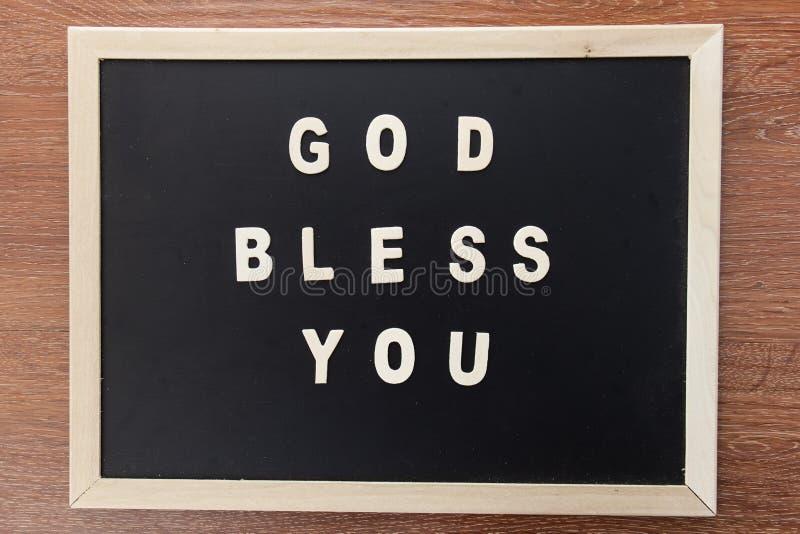 De houten vorm van de brieventekst bibleGOD zegent u royalty-vrije stock fotografie