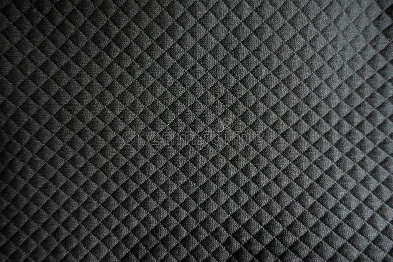 De hulp controleert patroon op zwarte polyester royalty-vrije stock foto's