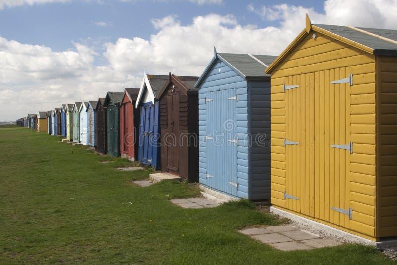 De Hutten van het strand in Dovercourt, Essex, Engeland stock afbeeldingen