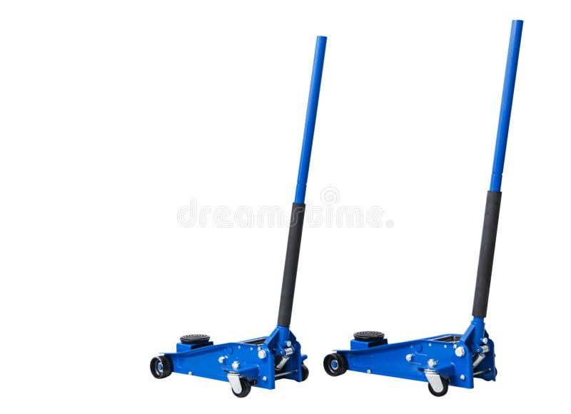 De hydraulische die hefbomen van de autovloer op witte achtergrond worden geïsoleerd Autolift Het blauwe Hydraulische de auto van stock foto's