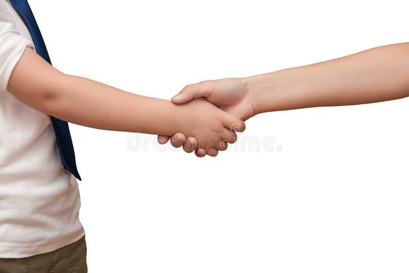 De IMG_5483-2child` s hand schudt handen met een tiener op witte B royalty-vrije stock afbeeldingen