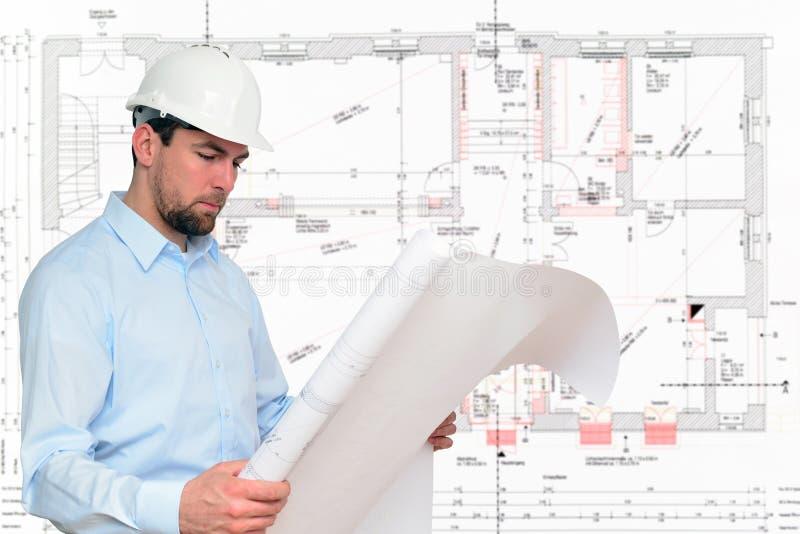De ingenieur van de bouwmanager de bouw van het planningshuis royalty-vrije stock fotografie