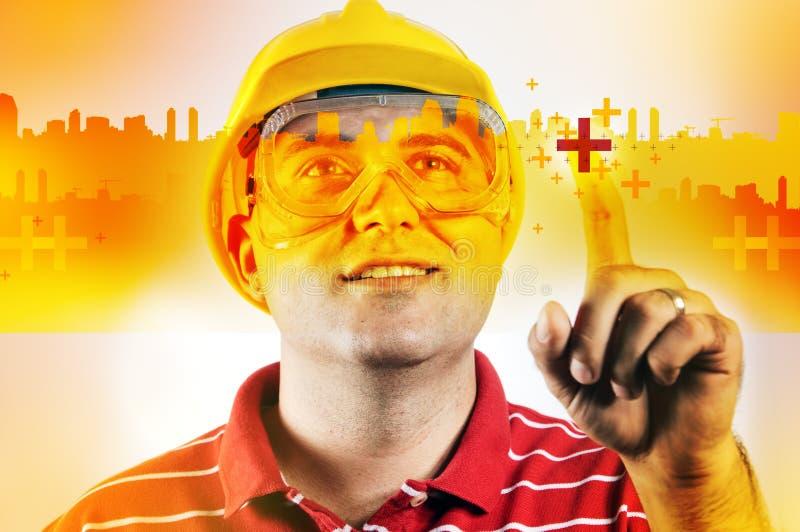 De ingenieur van de bouw met het aanrakingsscherm stock afbeeldingen