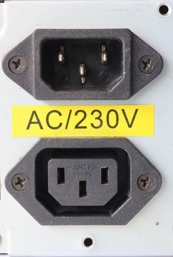 de inham en de afzet van de 220 voltmacht voor voeding stock foto
