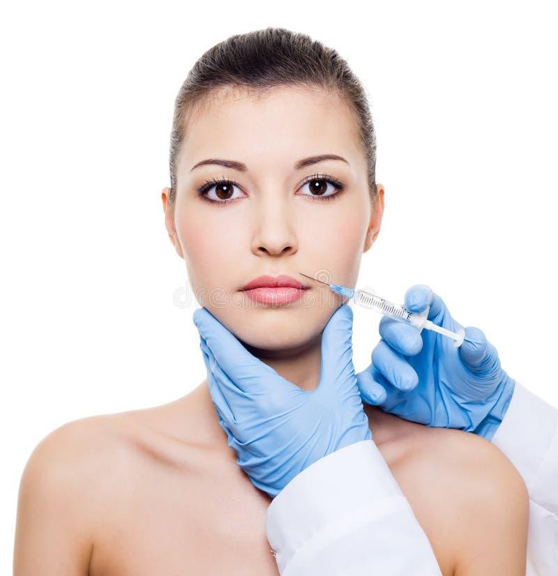 De injectie van Botox in vrouwenlippen royalty-vrije stock foto