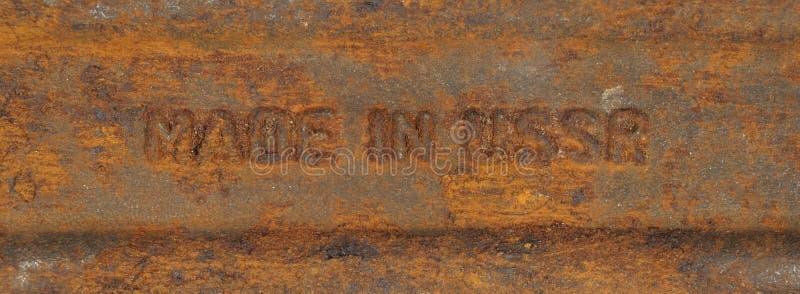 De inschrijving maakte in de USSR op een roestig metaal stock foto