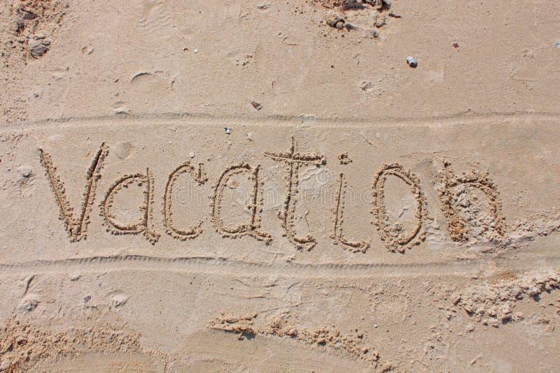De inschrijving op het strandzand - Vakantie royalty-vrije stock foto's