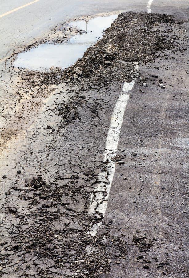 De instorting van het asfaltwegdek royalty-vrije stock fotografie