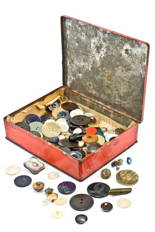 De inzameling van kledingsknopen in oude tindoos royalty-vrije stock foto's
