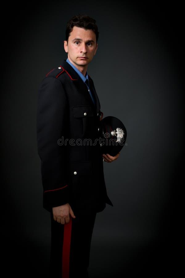 De Italiaanse grijze achtergrond van de carabinierekadet stock foto