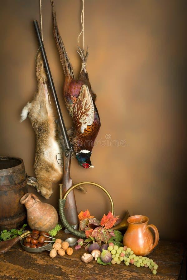 De jachthoorn en spel stock afbeeldingen