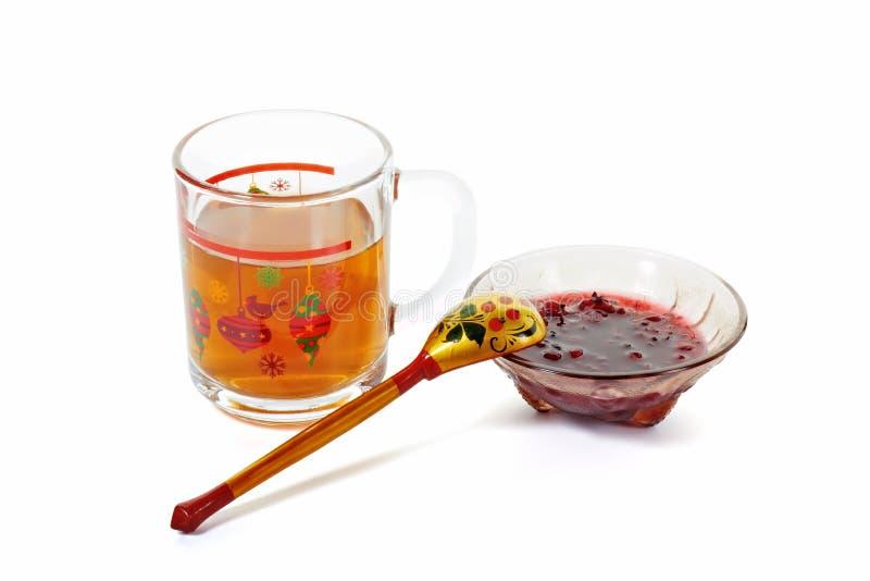 De jam en de thee van de rode aalbes stock fotografie