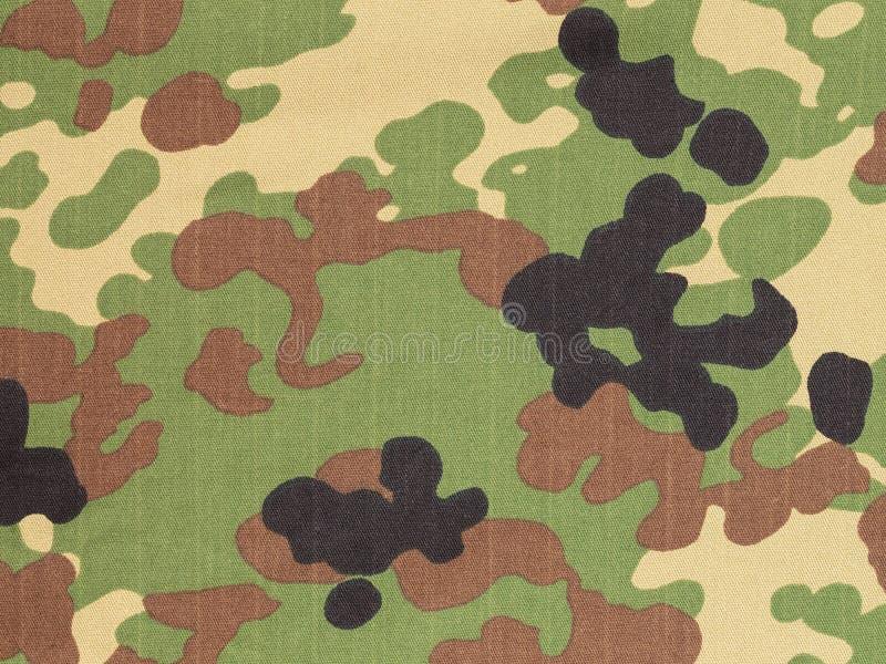 De Japanse bewapende stof van de kracht flecktarn camouflage stock foto's