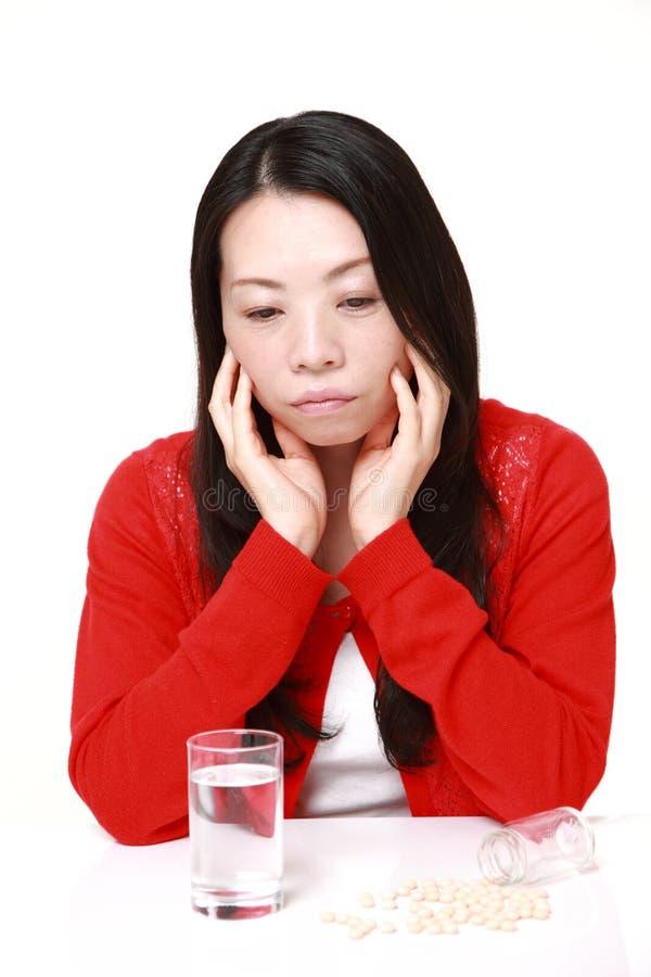 De Japanse vrouw lijdt aan melancholie stock foto