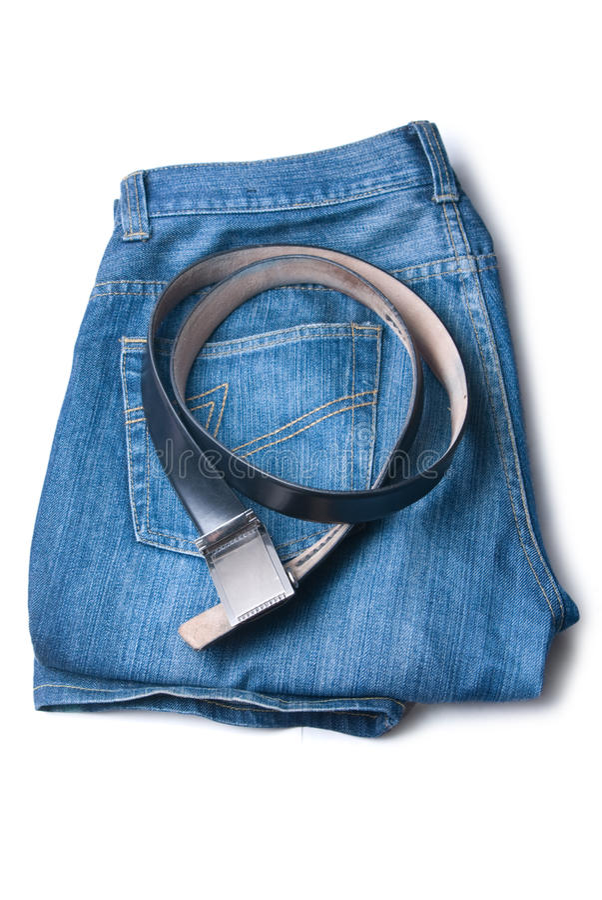 De jeans en de riem worden gecombineerd door een stapel royalty-vrije stock fotografie