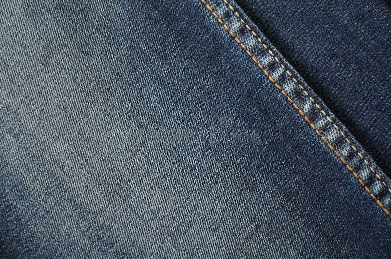 De jeans op de volledige achtergrond sluiten omhoog horizontaal stock foto's