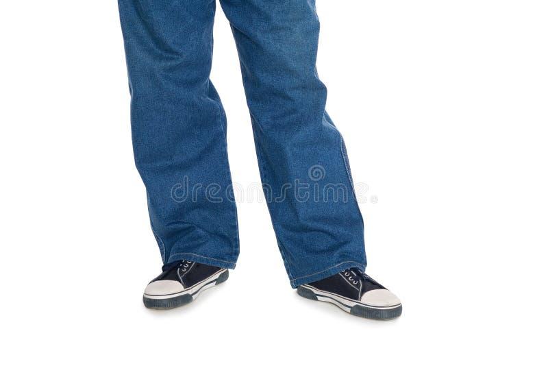 De jeans van mensen en gumshoes. royalty-vrije stock afbeeldingen