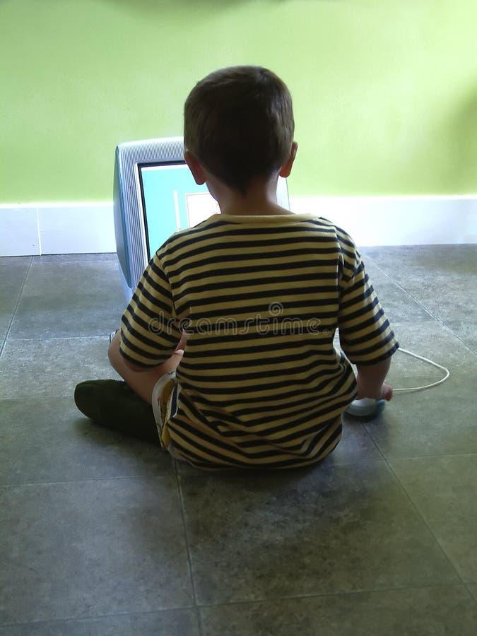 De jeugd op computer stock fotografie