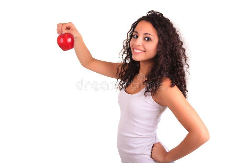 De jonge appel van de vrouwenholding. Geïsoleerd over wit stock afbeeldingen