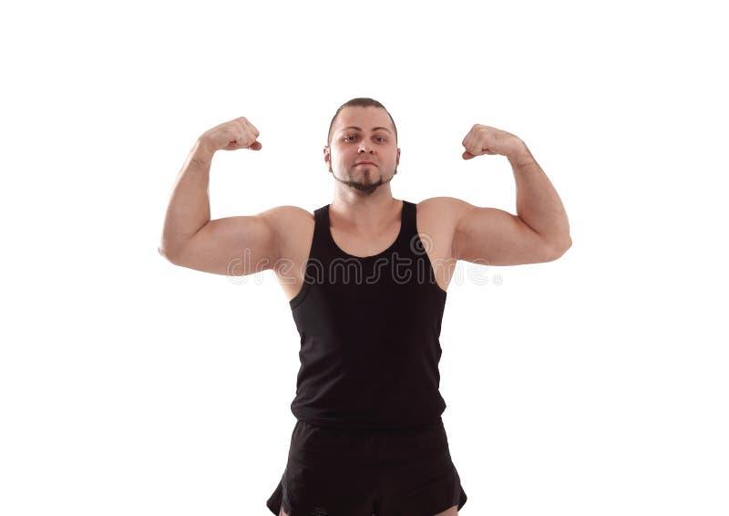 De jonge atletische mensen toont spier na een training Geïsoleerd op wit royalty-vrije stock afbeelding