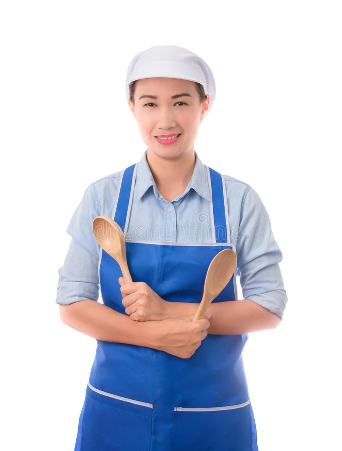 De jonge Aziatische chef-kok, zekere huisvrouw stelt en holding een spatel royalty-vrije stock foto