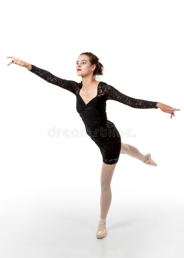 De jonge balletdanser in arabesque stelt royalty-vrije stock foto's