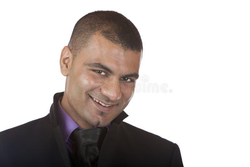 De jonge Bedrijfsmens glimlacht in camera stock foto
