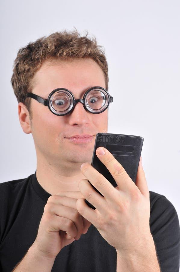 De jonge bizarre calculator van de mensenholding royalty-vrije stock afbeeldingen