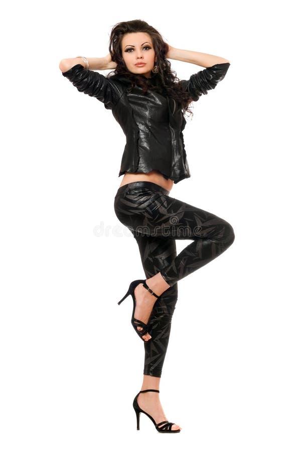 De jonge brunette van Nice in zwarte kleren royalty-vrije stock foto