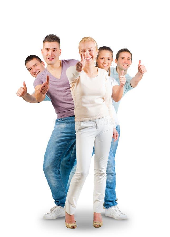 De jonge en mensen die beduimelen omhoog bevinden zich tonen stock afbeelding