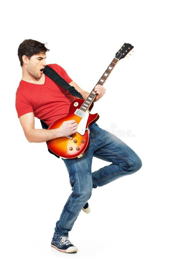 De jonge gitarist speelt op de elektrische gitaar royalty-vrije stock afbeeldingen