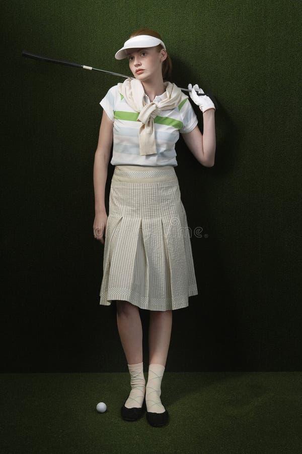 De jonge Golfclub van de Vrouwenholding royalty-vrije stock fotografie