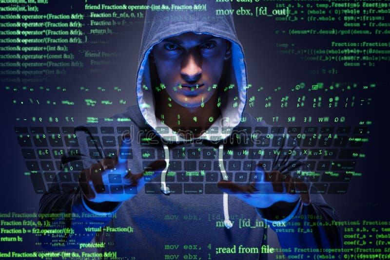 De jonge hakker in het concept van de cyberveiligheid stock afbeelding