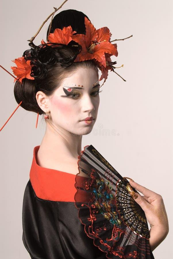 De jonge Japanse vrouw stock afbeeldingen